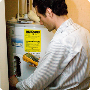Plumber diagnoses a GE water heater before a repair