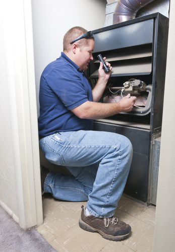 John is one of our Highlands Ranch HVAC repair and installation pros and he is doing a maintenance check